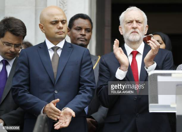Britain's Home Secretary Sajid Javid and Jeremy Corbyn opposition Labour party leader applaud on the steps of Islington Town Hall on the anniversary...
