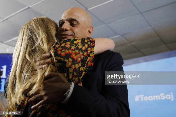 Britain's Home Secretary Sajid Javid embraces his wife Laura after speaking at his Conservative Party leadership campaign launch in London on June 12...