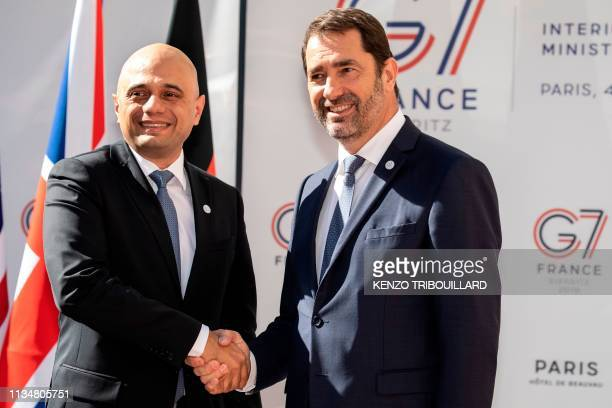 Britain's Home Secretary Sajid Javid shakes hands with French Interior Minister Christophe Castaner as he arrives at the Ministry of Interior Place...