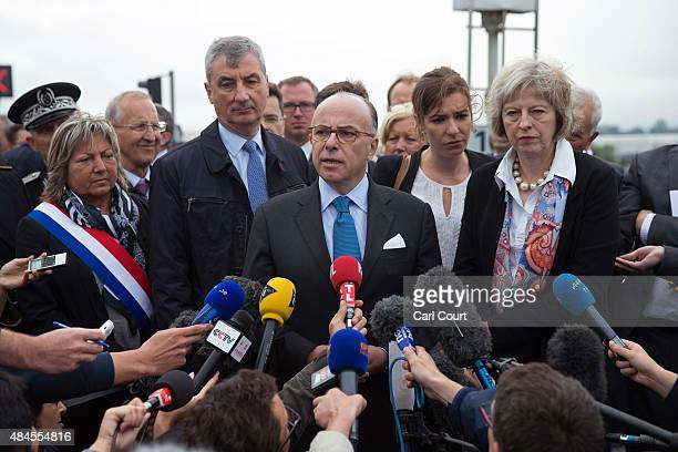 Britain's Home Secretary Theresa May and Natacha Bouchart the mayor of Calais look on as French Interior Minister Bernard Cazeneuve addresses the...