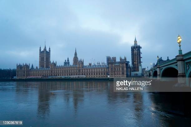 Britain's Houses of Parliament is seen at sunrise in London on December 31, 2020 on the day that the Brexit transition period ends and Britain leaves...
