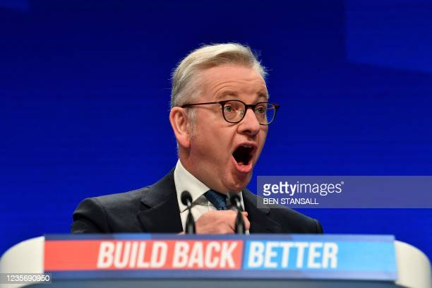 Britain's Housing Secretary Michael Gove speaks on the second day of the annual Conservative Party Conference being held at the Manchester Central...