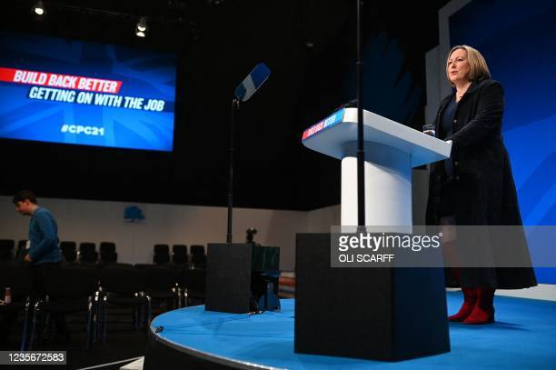 Britain's International Trade Secretary Anne-Marie Trevelyan makes a speech on the first day of the annual Conservative Party Conference, held at the...