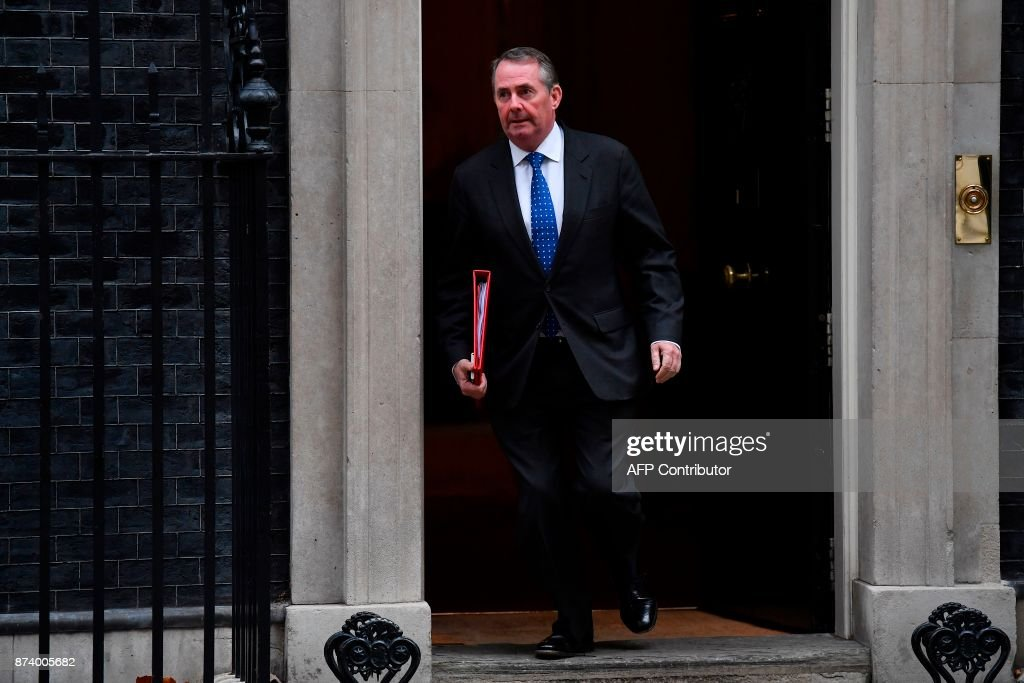 Britain's International Trade Secretary Liam Fox leaves 10 Downing Street after attending the weekly meeting of the Cabinet in central London on November 14, 2017. British Prime Minister Theresa May begins a major parliamentary battle over Brexit on Tuesday, facing competing demands by MPs to change her strategy as tensions rise among her scandal-hit ministers. MPs will have their first chance to scrutinise the EU Withdrawal Bill, which would formally end Britain's membership of the European Union and transfer four decades of EU legislation into UK law. / AFP PHOTO / Ben STANSALL