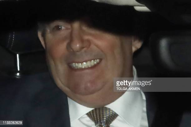 Britain's International Trade Secretary Liam Fox leaves by car from the Houses of Parliament in Westminster London on March 28 2019 Prime Minister...