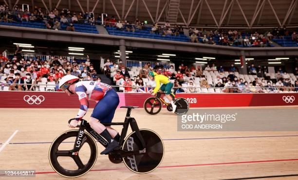 Britain's Jack Carlin and Australia's Nathan Hart compete in a heat of the men's track cycling sprint 1/32 finals during the Tokyo 2020 Olympic Games...
