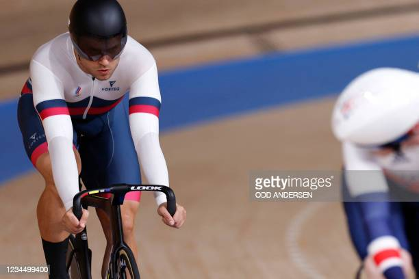 Britain's Jack Carlin competes against Russia's Denis Dmitriev in the men's track cycling sprint finals during the Tokyo 2020 Olympic Games at Izu...