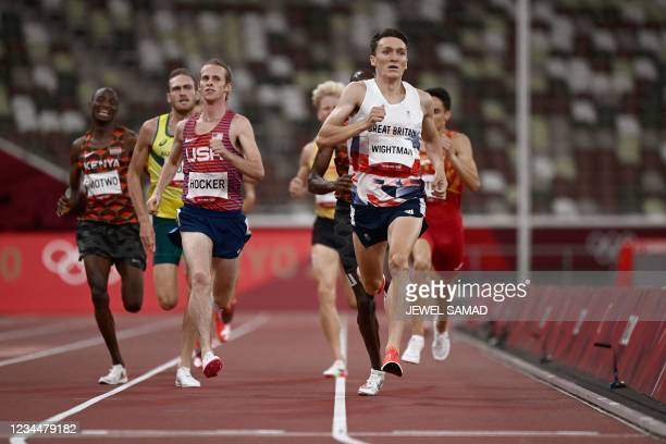 Britain's Jake Wightman crosses the finish line to win in the men's 1500m semi-finals during the Tokyo 2020 Olympic Games at the Olympic Stadium in...