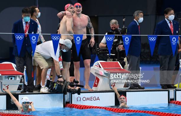 Britain's James Guy , Britain's Adam Peaty and Britain's Anna Hopkin celebrate setting a new World Record to win and take gold in the final of the...