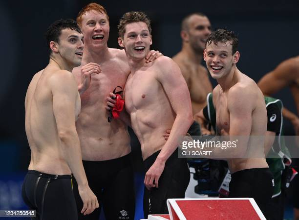 Britain's James Guy, Britain's Tom Dean, Britain's Duncan Scott and Britain's Matthew Richards react after winning the final of the men's 4x200m...