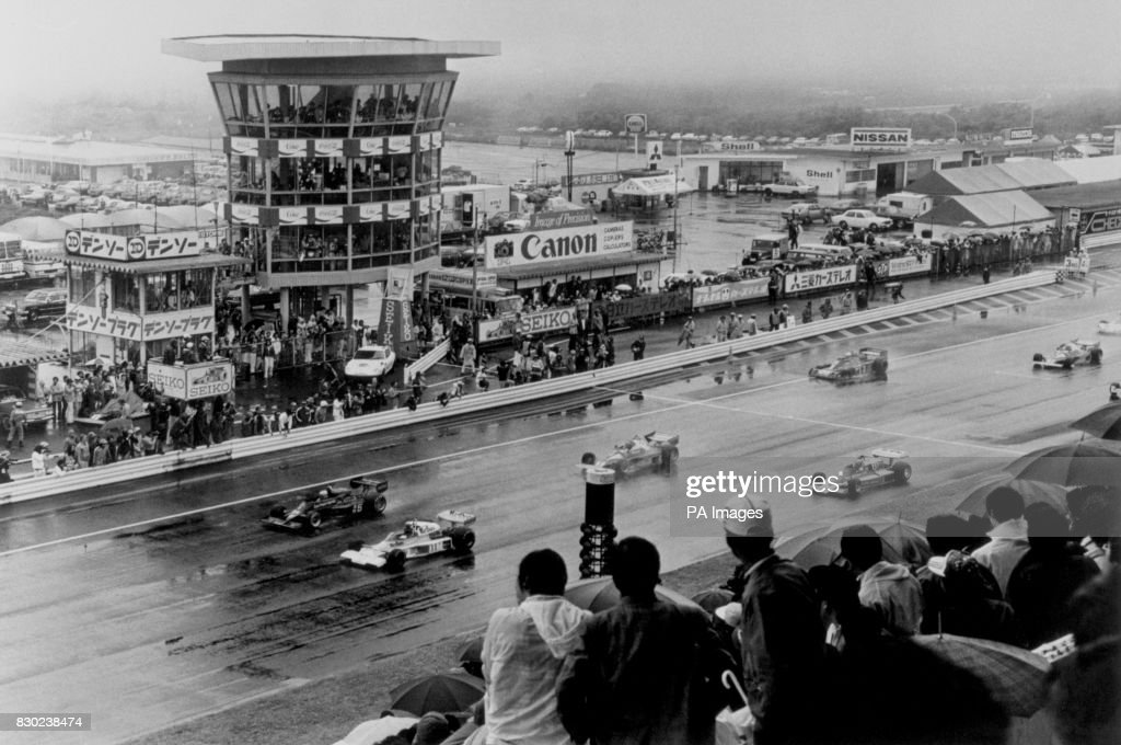 Britain's James Hunt driving a McLaren (11) and Mario Andretti in a Lotus (5) lead the way during the Japanese Grand Prix at Fuji.