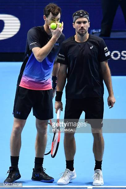 Britain's Jamie Murray and Brazil's Bruno Soares react during a break in play against US player Mike Bryan and US player Jack Sock during their men's...