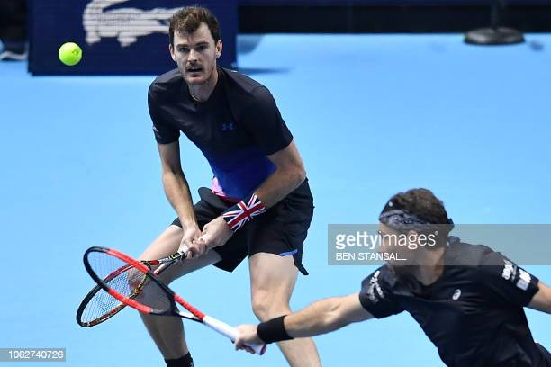 Britain's Jamie Murray and Brazil's Bruno Soares return against US player Mike Bryan and US player Jack Sock during their men's doubles semifinal...