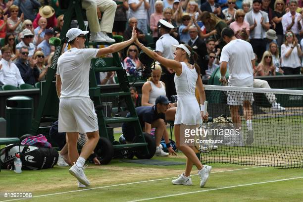 Britain's Jamie Murray and Switzerland's Martina Hingis reacts after winning against Britain's Ken Skupski and Britain's Jocelyn Rae during their...
