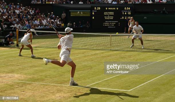 Britain's Jamie Murray and Switzerland's Martina Hingis return against Britain's Ken Skupski and Britain's Jocelyn Rae during their mixed doubles...