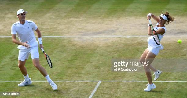 Britain's Jamie Murray and Switzerland's Martina Hingis return the ball during their mixed doubles second round match against Britain's Anna Smith...