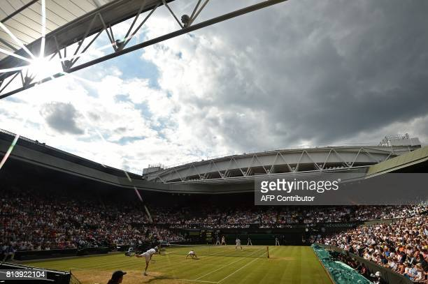 Britain's Jamie Murray and Switzerland's Martina Hingis serve against Britain's Ken Skupski and Britain's Jocelyn Rae during their mixed doubles...