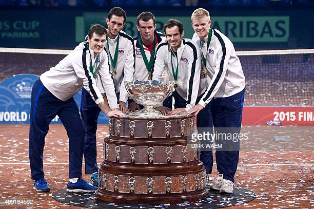 Britain's Jamie Murray Britain's James Ward Britain's captain Leon Smith Britain's Andy Murray and Britain's Kyle Edmund pose with the trophy after...