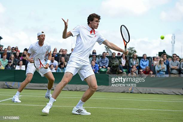 Britain's Jamie Murray plays a backhand shot during his second round men's doubles match with US player Eric Butorac against France's Michael Llodra...