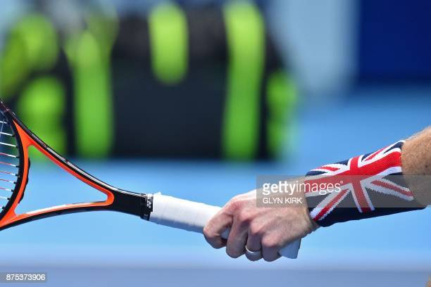 Britain's Jamie Murray wears a Union flag sweat band as he plays with his partner Brazil's Bruno Soares in their men's doubles roundrobin match...