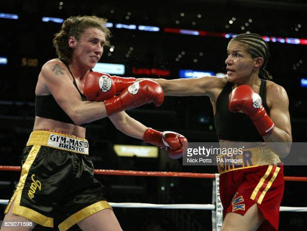 Britain's Jane Couch take heavy right hand punch from American Lucia Rijker during Couch's points defeat at Junior Middleweight at the Staples Centre...