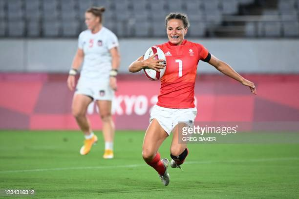 Britain's Jasmine Joyce scores a try in the women's quarter-final rugby sevens match between USA and Britain during the Tokyo 2020 Olympic Games at...