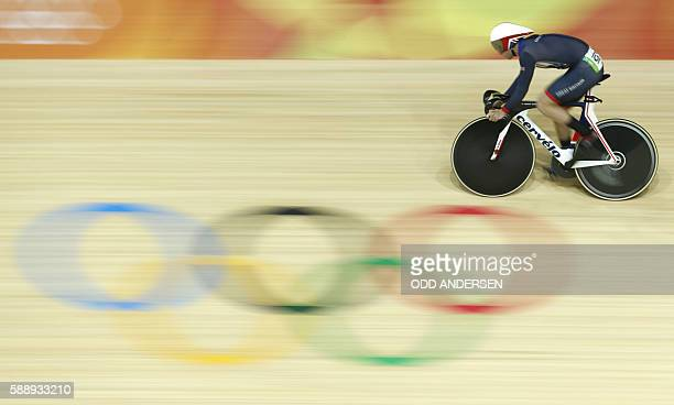 TOPSHOT Britain's Jason Kenny competes in the men's Sprint qualifying track cycling event at the Velodrome during the Rio 2016 Olympic Games in Rio...