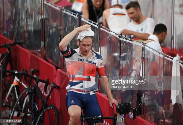 Britain's Jason Kenny warms down after competing in a heat of the men's track cycling sprint 1/32 finals during the Tokyo 2020 Olympic Games at Izu...