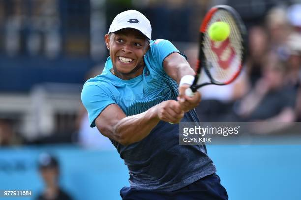 Britain's Jay Clarke returns to US player Sam Querrey during their first round men's singles match at the ATP Queen's Club Championships tennis...