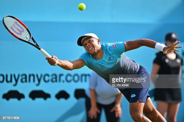 TOPSHOT Britain's Jay Clarke stretches to reach a forehand during his defeat to US player Sam Querrey in their first round men's singles match at the...