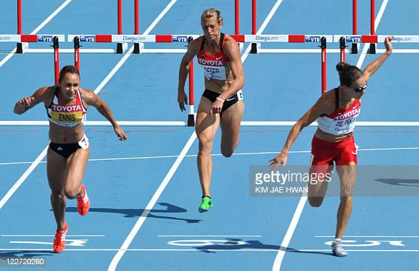 Britain's Jessica Ennis Germany's Jennifer Oeser and Canada's Jessica Zelinka compete in the 100 metres hurdles of the women's heptathlon event at...