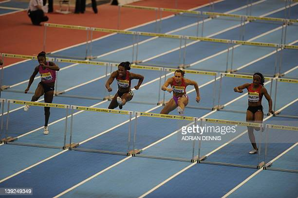 Britain's Jessica Ennis on her way to victory over USA's Danielle Carruthers in the Women's 60m hurdles at the Aviva Grand Prix at The National...