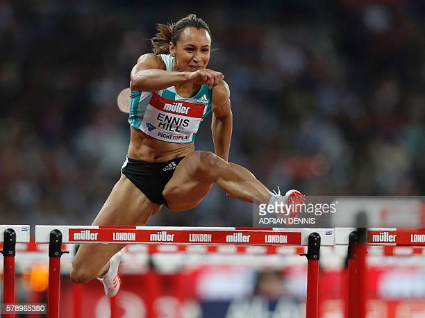Britain's Jessica EnnisHill clears a hurdle in a final of the women's 100m hurdles at the IAAF Diamond League Anniversary Games athletics meeting at...