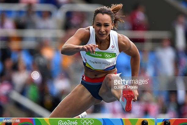 TOPSHOT Britain's Jessica EnnisHill competes in the Women's Heptathlon 100m Hurdles during the athletics event at the Rio 2016 Olympic Games at the...