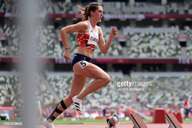 Britain's Jessica Turner competes in the women's 400m hurdles heats during the Tokyo 2020 Olympic Games at the Olympic Stadium in Tokyo on July 31,...