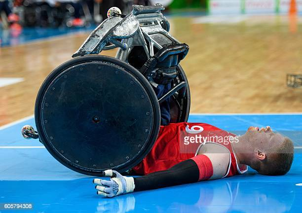 Britain's Jim Roberts topples over during the Australia vs Great Britain in the Mixed Pool Phase Group A Match 01 Wheelchair Rugby at the Carioca...