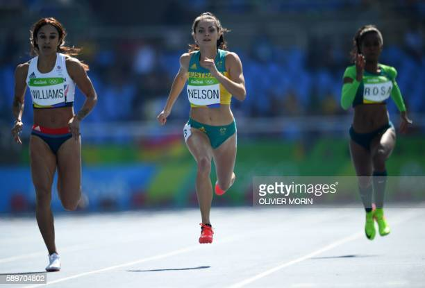 Britain's Jodie Williams and Australia's Ella Nelson compete in the Women's 200m Round 1 during the athletics event at the Rio 2016 Olympic Games at...