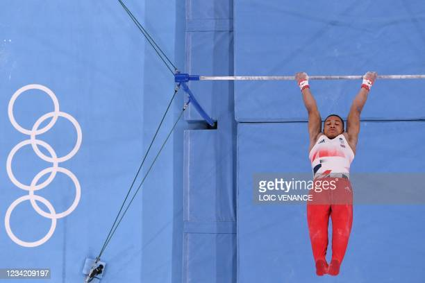 Britain's Joe Fraser competes in the horizontal bars event of the artistic gymnastics men's team final during the Tokyo 2020 Olympic Games at the...