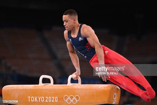 Britain's Joe Fraser competes in the pommel horse event of the artistic gymnastics men's all-around final during the Tokyo 2020 Olympic Games at the...