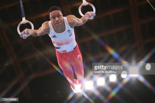 Britain's Joe Fraser competes in the rings event of the artistic gymnastics men's team final during the Tokyo 2020 Olympic Games at the Ariake...