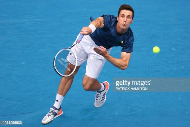 Britain's Joe Salisbury serves as he plays with partner Rajeev Ram of the US during their men's doubles final match against Croatia's Ivan Dodig and...