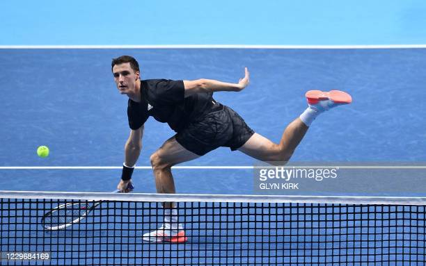 Britain's Joe Salisbury stretches for a return shot against Germany's Kevin Krawietz and Germany's Andreas Miesin their men's doubles round-robin...
