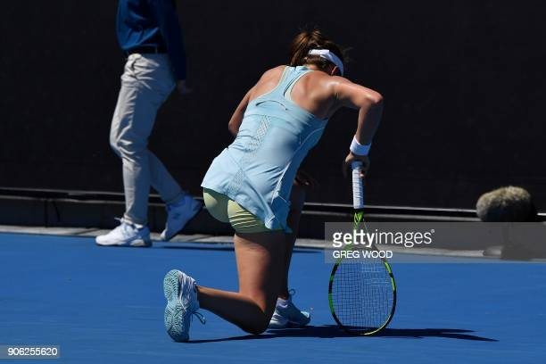Britain's Johanna Konta falls during their women's singles second round match against Bernarda Pera of the US on day four of the Australian Open...