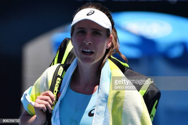 Britain's Johanna Konta leaves the court after her defeat during her women's singles second round match against Bernarda Pera of the US on day four...