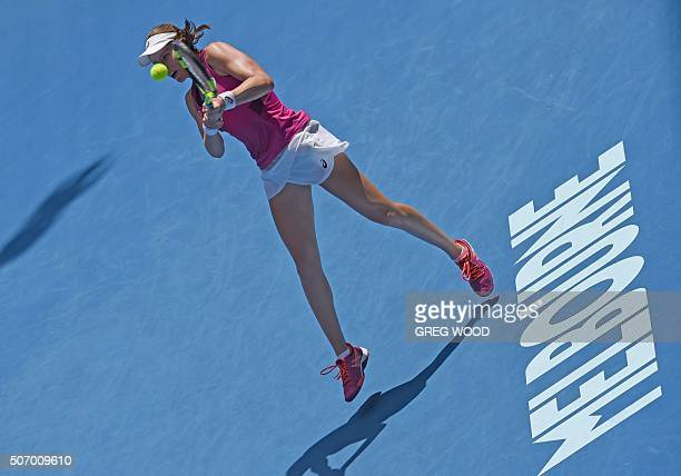Britain's Johanna Konta plays a backhand return during her women's singles match against China's Zhang Shuai on day ten of the 2016 Australian Open...