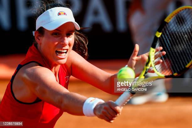 Britain's Johanna Konta plays a backhand to Spain's Garbine Muguruza during their round 3 match on day five of the Women's Italian Open at Foro...