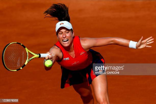 Britain's Johanna Konta plays a forehand to Spain's Garbine Muguruza during their round 3 match on day five of the Women's Italian Open at Foro...