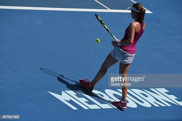 Britain's Johanna Konta prepares to serve during her women's singles match against China's Zhang Shuai on day ten of the 2016 Australian Open tennis...