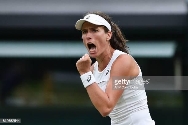 TOPSHOT Britain's Johanna Konta reacts after winning the second set tiebreak against Romania's Simona Halep during their women's singles quarterfinal...