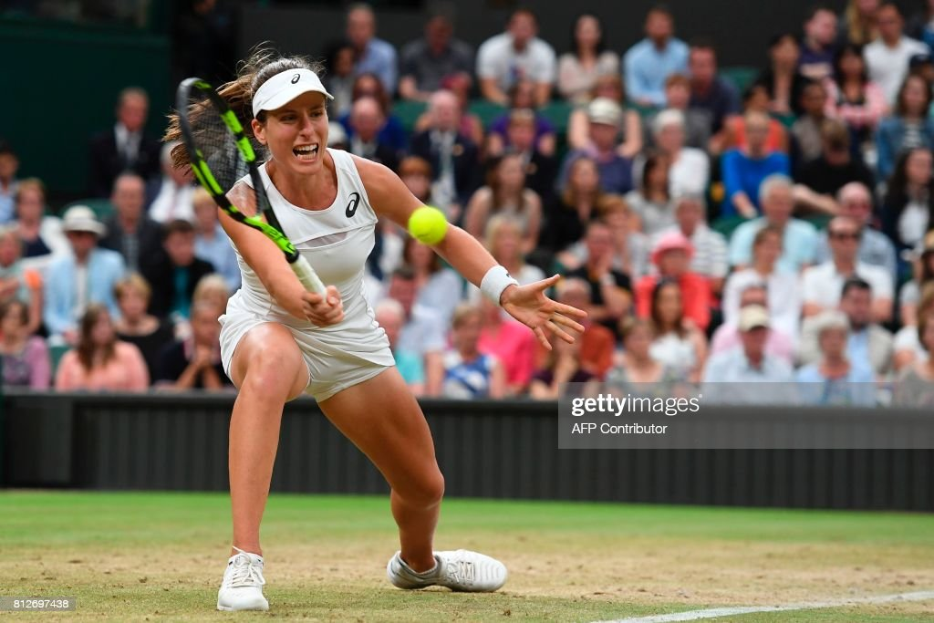 TOPSHOT - Britain's Johanna Konta returns against Romania's Simona Halep during their women's singles quarter-final match on the eighth day of the 2017 Wimbledon Championships at The All England Lawn Tennis Club in Wimbledon, southwest London, on July 11, 2017. / AFP PHOTO / Glyn KIRK / RESTRICTED